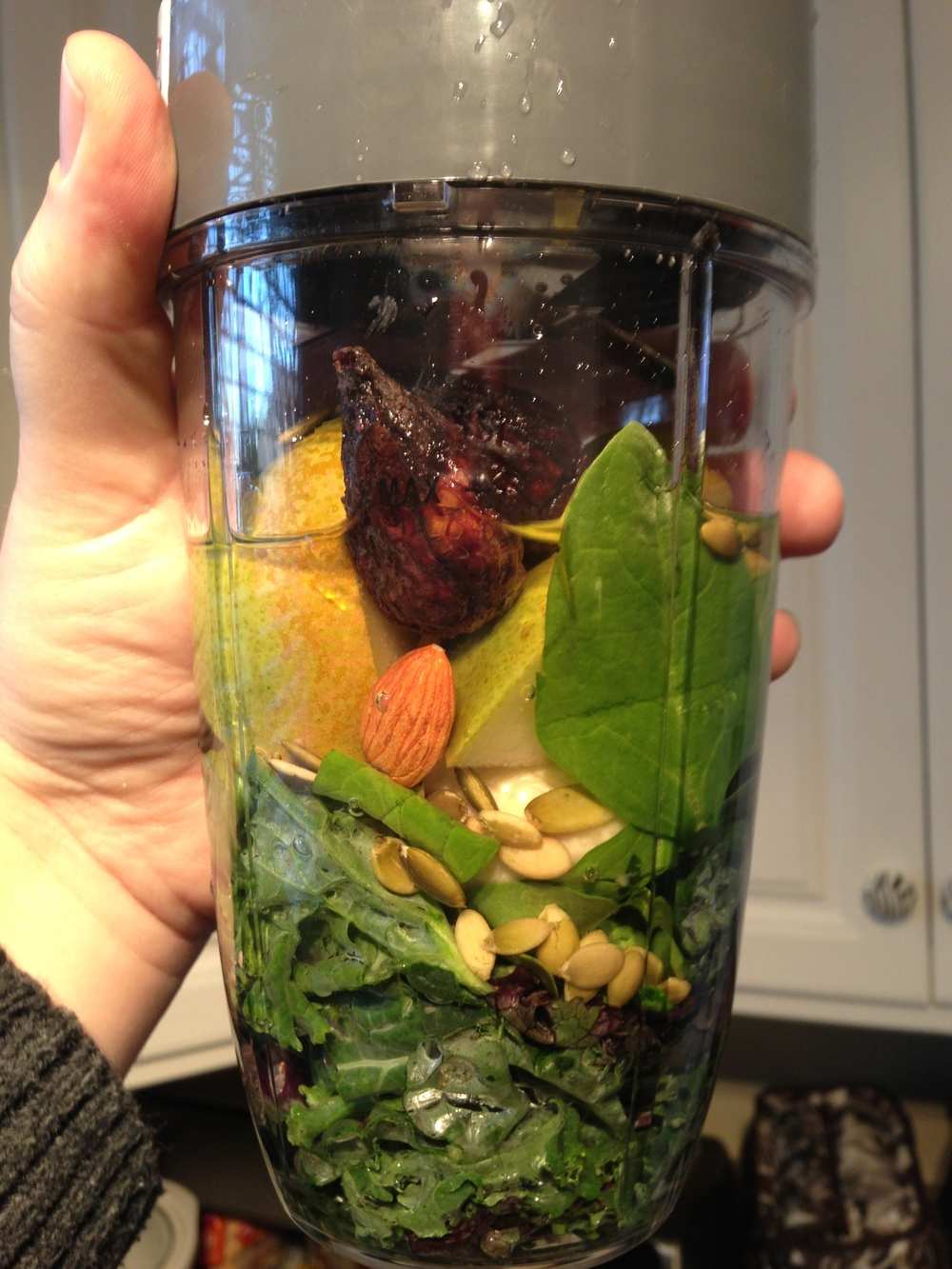 Dan's drink...banana, pear, kale, spinach, mango, pumpkin seeds, a fig