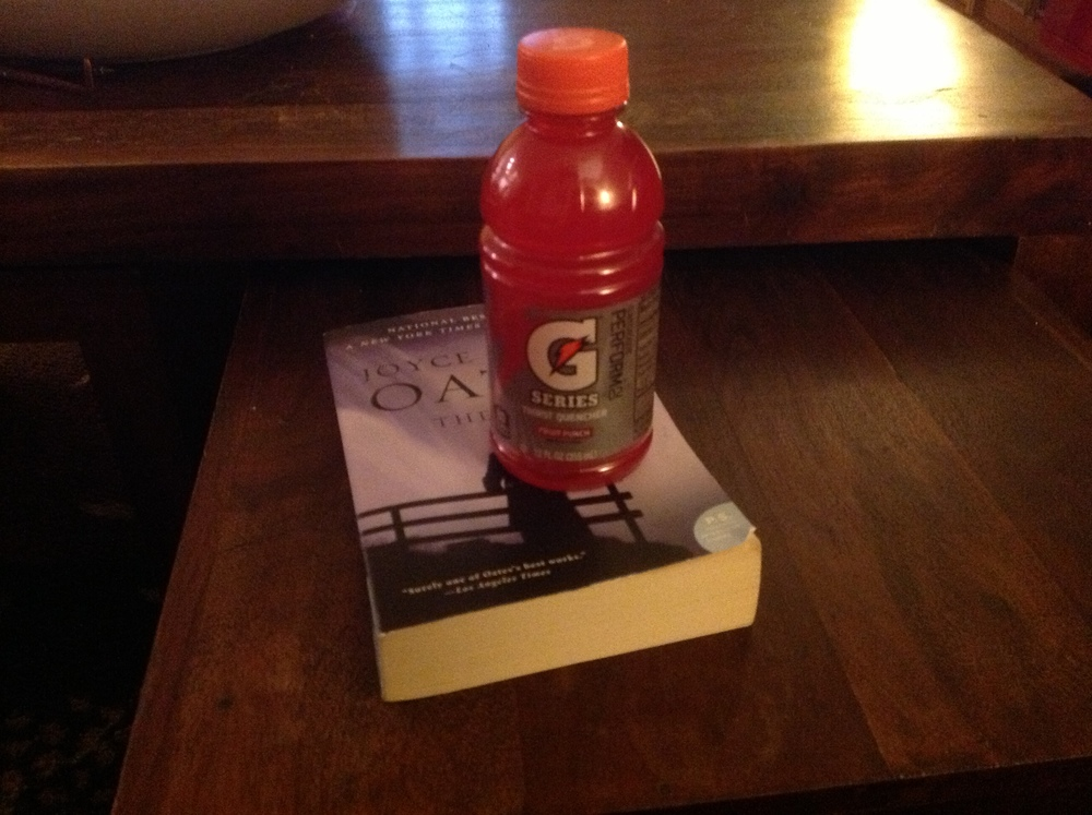 My Fruit Punch Gatorade sitting on top of the slowest read ever = my life with the stomach flu