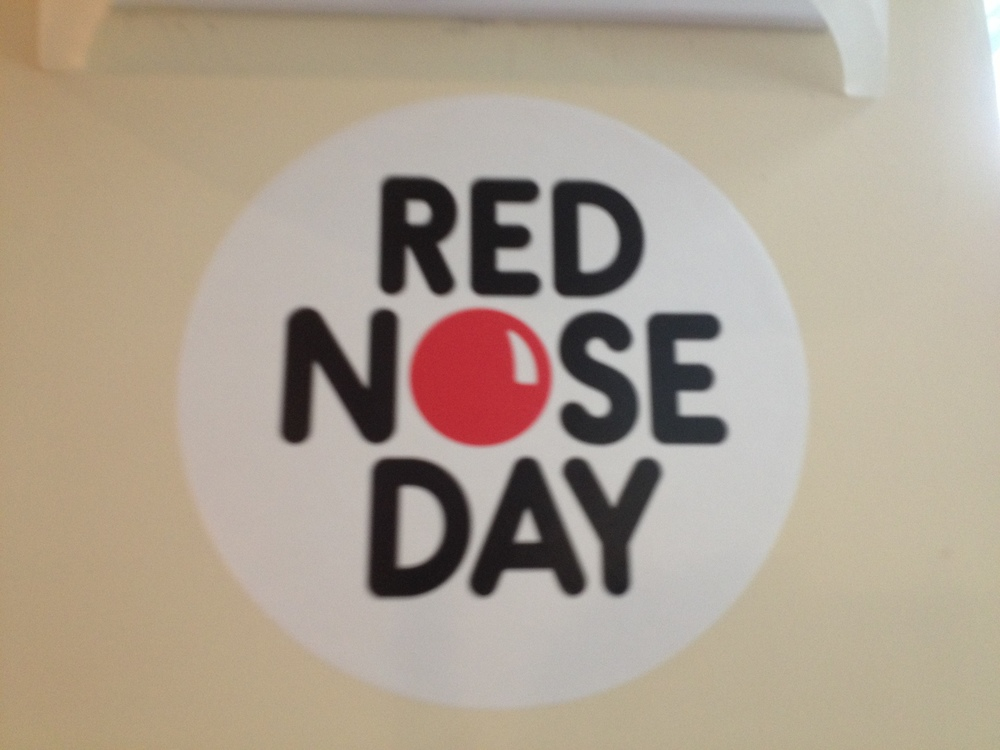 3/15/13 was Red Nose Day in England. This is a day of comedy to raise money for AID's relief in Africa. Everywhere we went we say promotions and advertisements for the day.