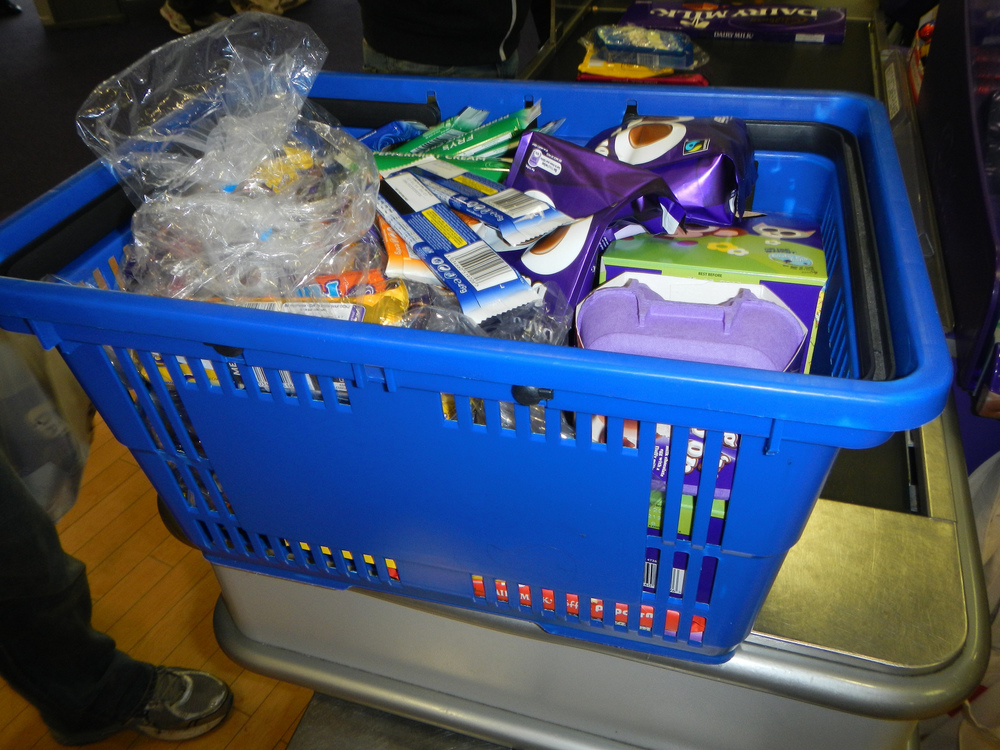 A very full basket of Cadbury products.