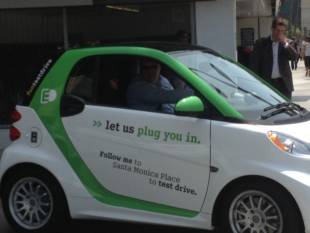 A happy Dan test driving the Electric Smart.