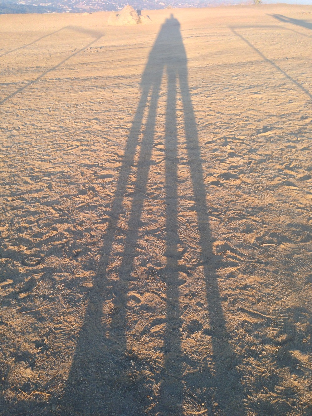 Our shadows at the top of a hill in Griffith Park.