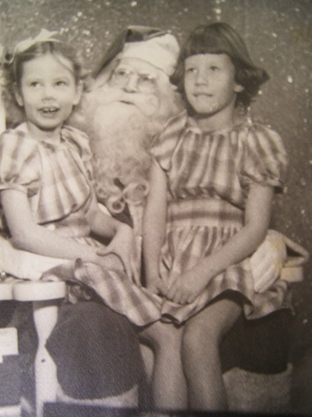 My aunt (left) and mom with Santa.