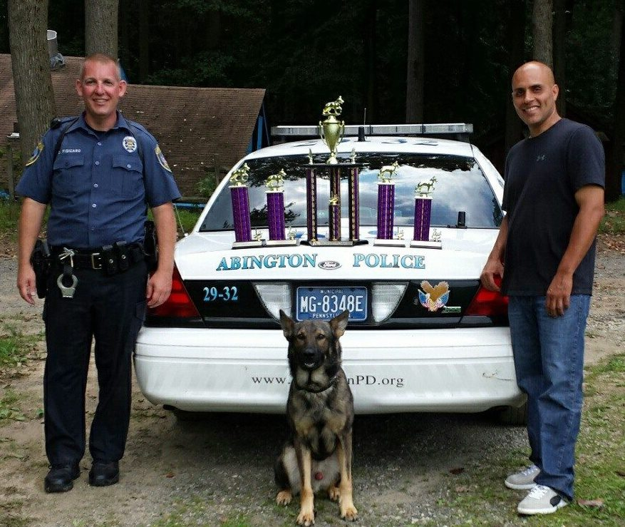 Officer Fisicaro and K-9 Matthews, Regional Champions 2013 pictured with trainer Sean Rivera.