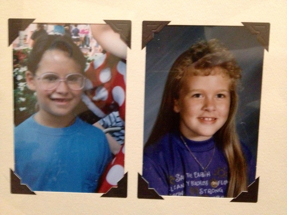 Carmen (left) and me (right) in the third grade.  Notice the pink glasses and poodle bangs - all the rage in the 1990s.