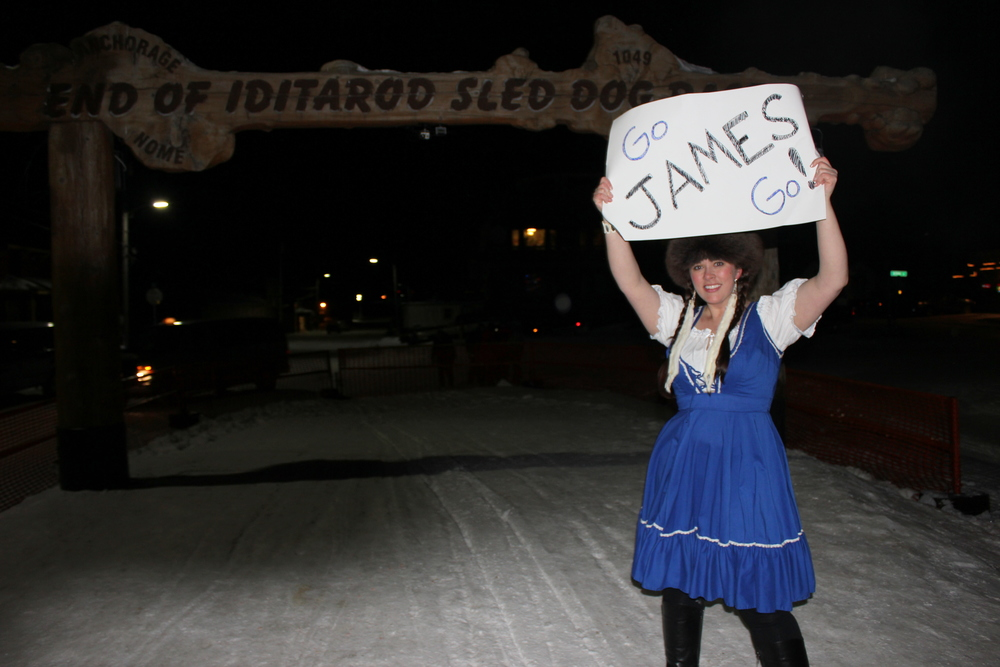 This, folks, is how you properly welcome a friend across the finish line!  I pulled out the St. Pauli Girl dress and topped it off, Alaska-style, with ermine earrings.