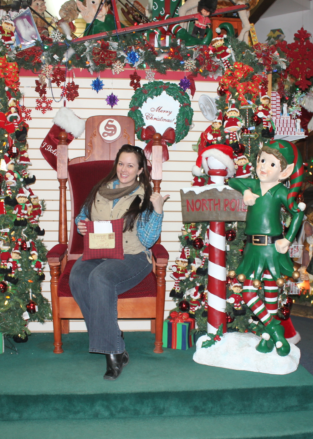 Stealing Santa's chair.  The elf got creeped out when I pointed to him.