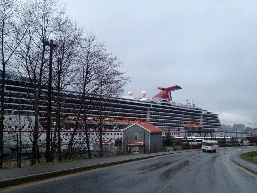 From far away, the cruise ship looks more like a massive building than a seafaring vessel.