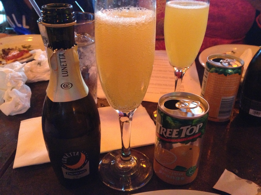 Mimosas + pizza = a winning combination.