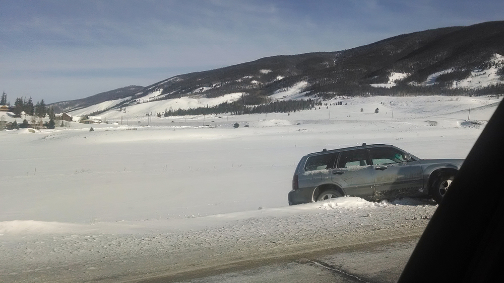 A car that has lost control on Swan Mountain Road and ended up perched above frozen Dillon Reservoir.