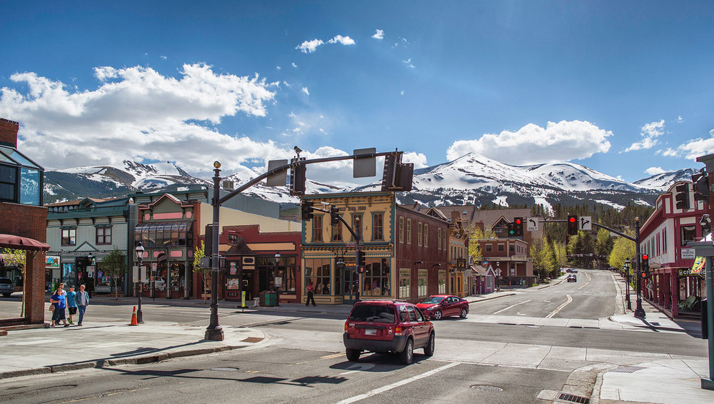 Downtown Breckenridge at the intersection of Lincoln Avenue and Main Street, facing west with a view of Breckenridge Ski Resort and Peak 8.