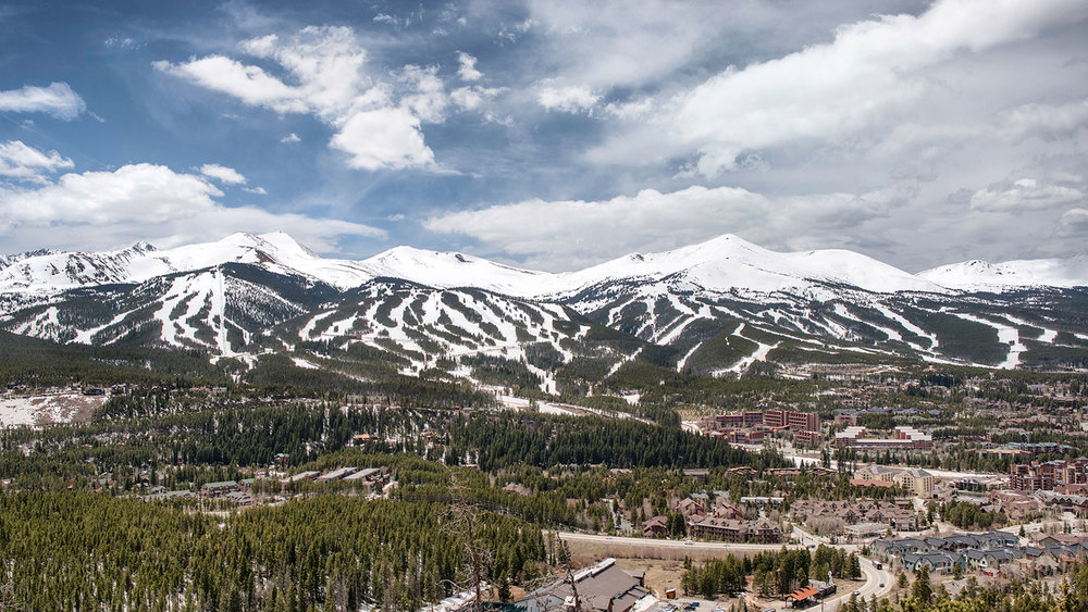 Looking west at the slopes of Breckenridge Ski Resort with the Town of Breckenridge in the foreground. The prominent peak to the right of center is Peak 8 and just below the summit can be seen a black speck - that is the top of the Imperial Express SuperChair, the highest ski-lift in the world.