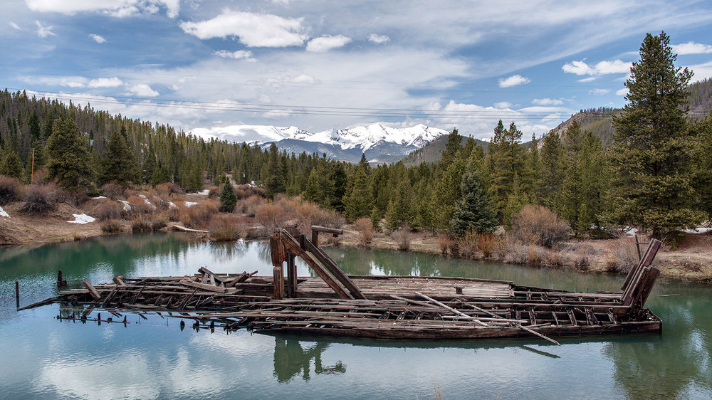 The Bucyrus Dredge, located just outside of Breckenridge on Tiger Road. Dredges like this one churned up riverbeds looking for gold, forever altering the history and landscape of Summit County. The water in this pond is colored green due to the presence of copper. Tenmile Range can be seen in the distance.