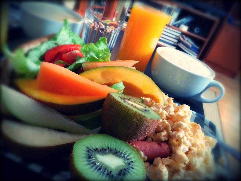 Nothing better than a proper meal with fruits, eggs, sausages, vegetables, freshly pressed orange juice and Italian coffee.
