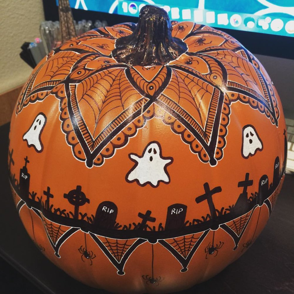 This year's entry for the company pumpkin contest. Sharpie & gel pen. Happy Halloween y'all! Wish me luck!