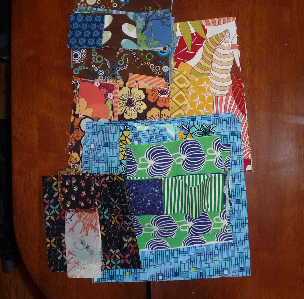 Over a dozen pairs of pot holders ready to be pieced!