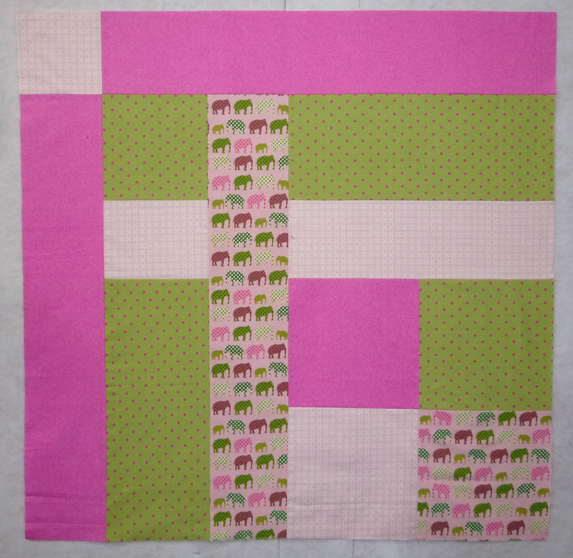 6.) This cute little preppy elephant lattice baby quilt