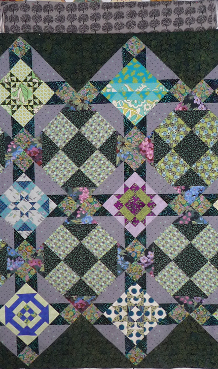 a BOM from a couple of years ago... all pieced by me, block in the upper left has a couple points missing their marks, the one in the lower right is the same, and you might notice the setting block where I had to substitute fabric after miscalculating and not being able to find more. Making due, man!