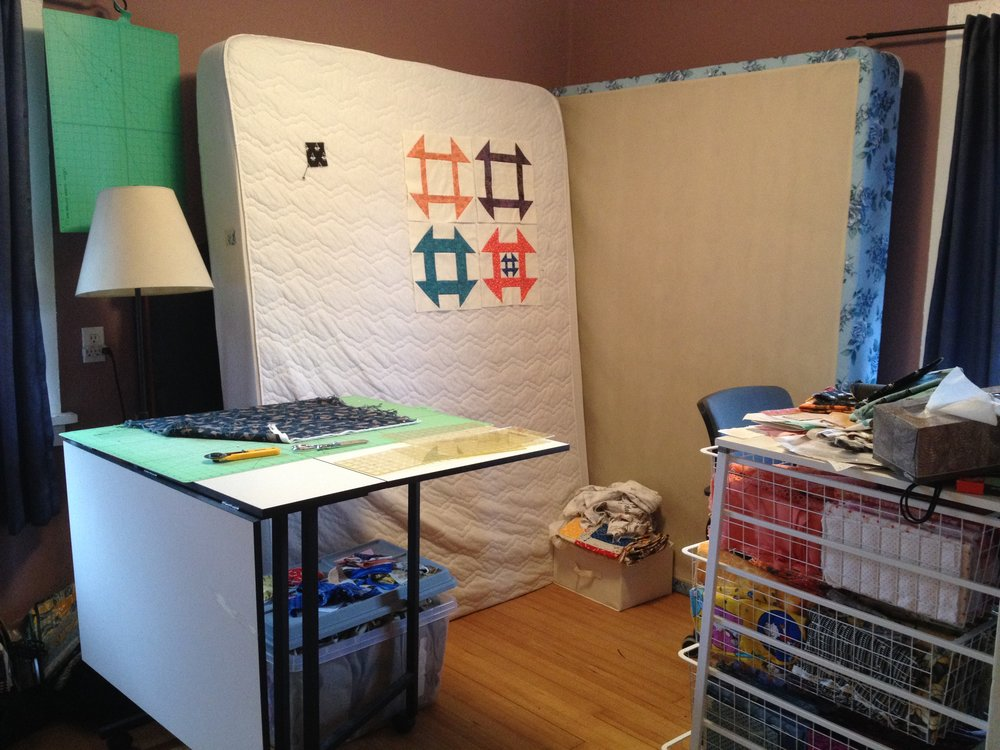 Yes, that's a mattress serving as my design wall, in our second bedroom that's been converted into my sewing room.