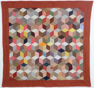 Please excuse the lack of credit here... I thought I had saved the source, but can't seem to relocate it now. :( However, this appears to be an example of a late 19th C. tumbling block charm quilt.