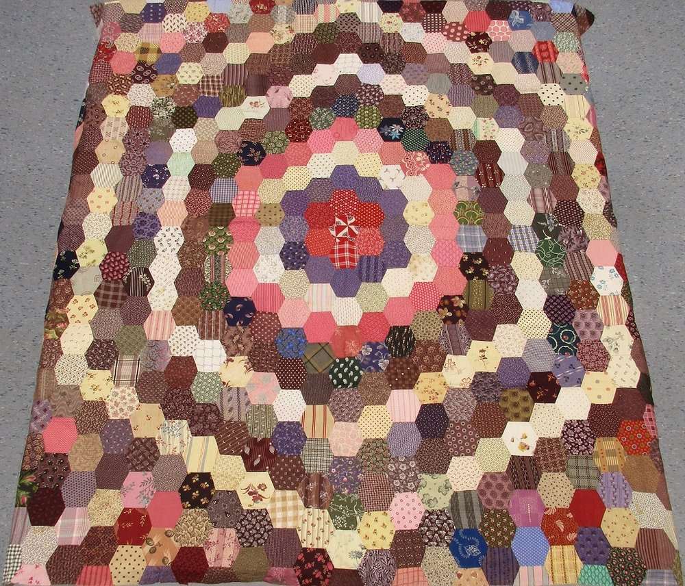 A quilt top found by a volunteer at Fanshawe Pioneer Village. Click on image to learn more.