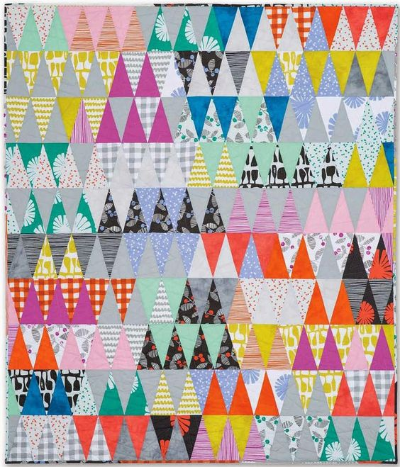 Carnival Quilt by Ashley Newcome. If you click the image, you will find a whole bunch of great triangle quilts and a link to some free patterns!