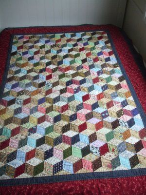 Another tumbling block quilt, by ariane's crafts, via Pinterest.