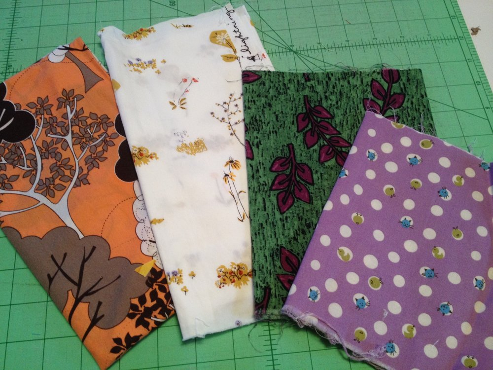 "Some examples of just a few of my ""precious"" fabrics. I will be sad when I use them up, but I'd be more so if I never used them at all."