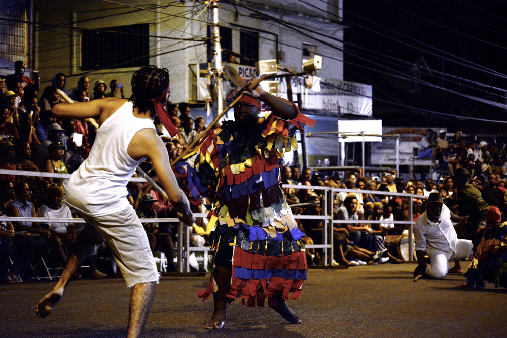 I had always heard about the Canboulay re-enactment but never saw it in person or even had an idea of what it really was. I was told it takes place very early in the morning, and was not in the best location in Port of Spain. Well, maybe that would be a turnoff for others, but not for me.