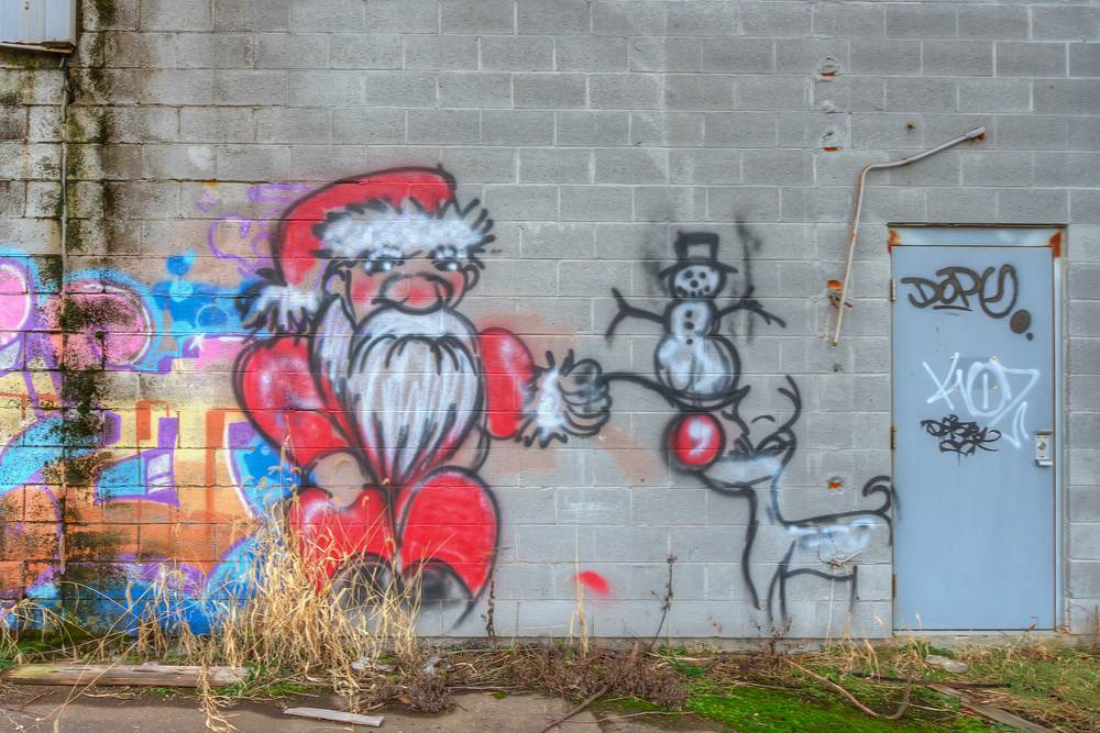 Santa, Reindeer, & Snowman Graffiti on abandoned factory building