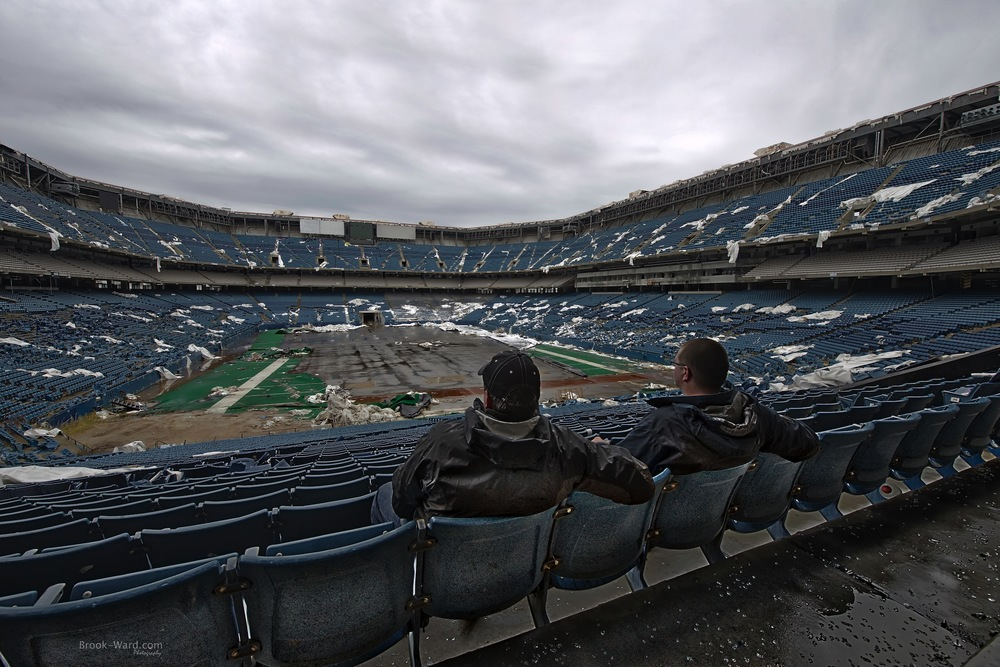 Blair and I sitting in the Abandoned Pontiac Silverdome