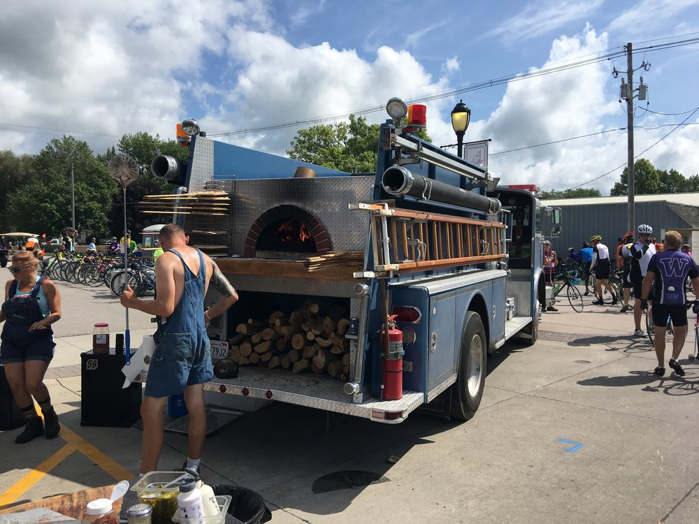 Wood fire oven pizza.  Oven was retrofitted into the back of an old firetruck.