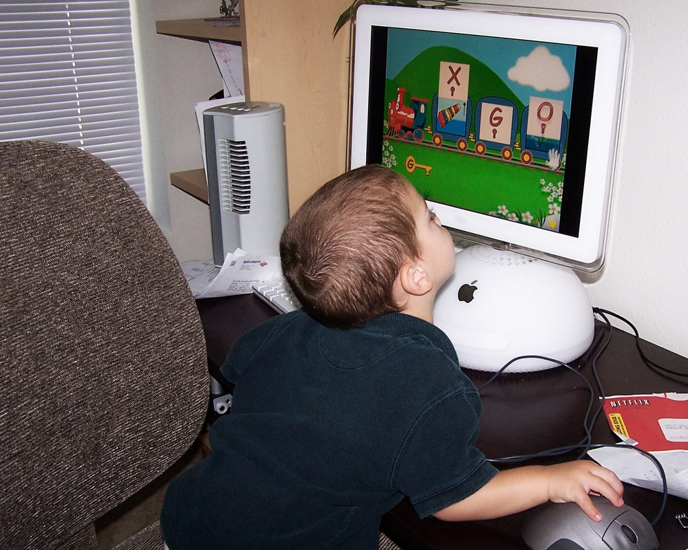My youngest son, Garin, when he was a little under 2 years old, getting acquainted with using a computer.