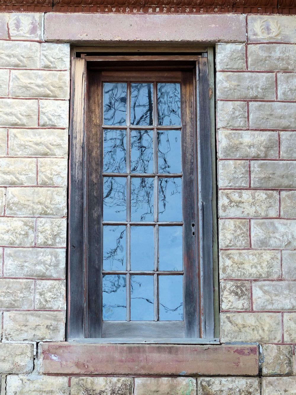 Creepy window on abandoned building