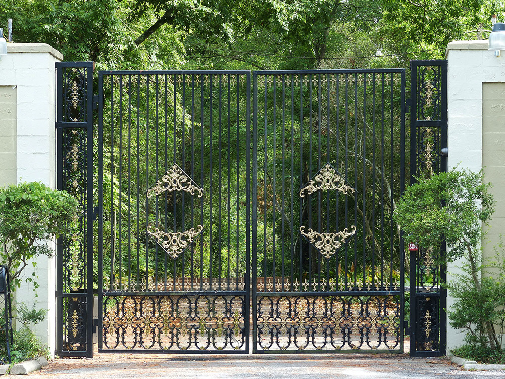 Gates to large estate that might be the birthplace of the present peacock population