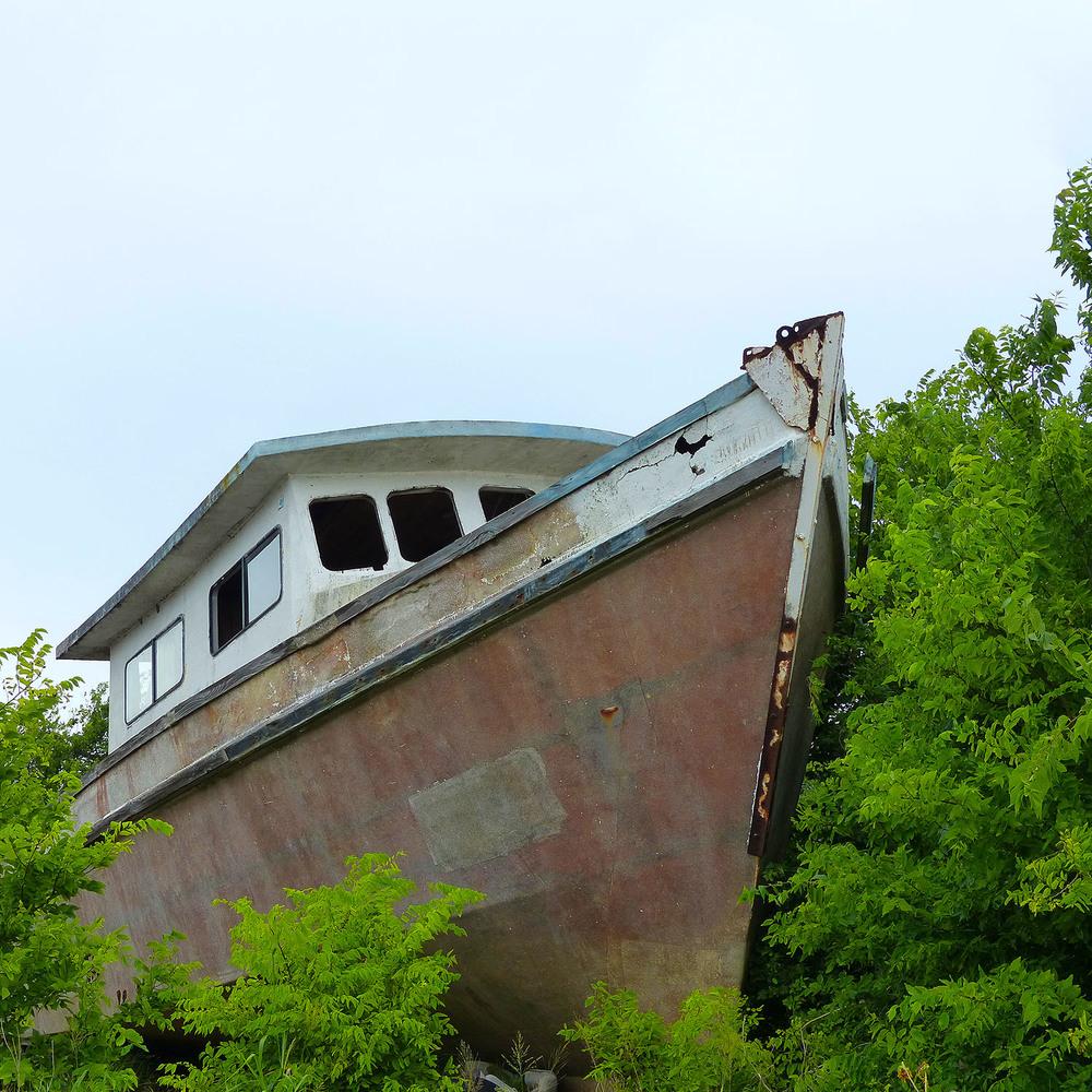 Rusted boat, junkyard in Tivoli, Texas
