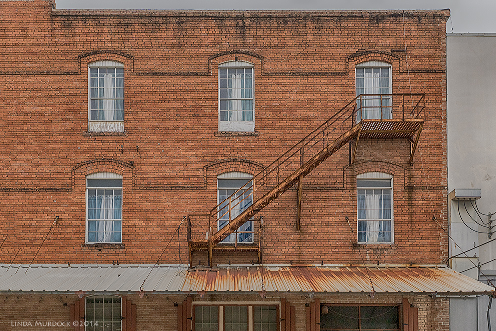 Fire escapes remind me of the  Triangle Shirtwaist Factory Fire     Sony A77 II with 16-50mm DT 1/250 sec. f/5.0 ISO 1000