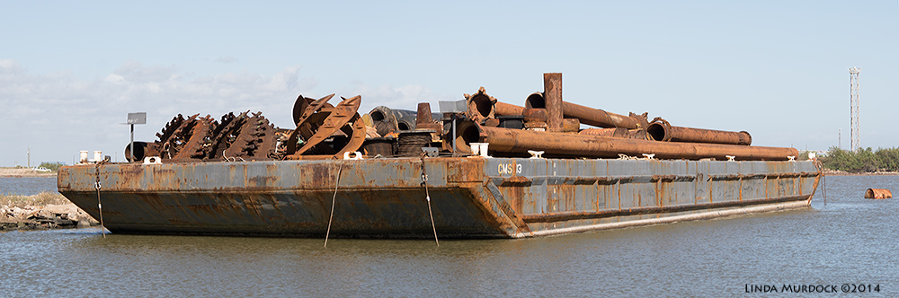 Panorama of pelican displacing barge