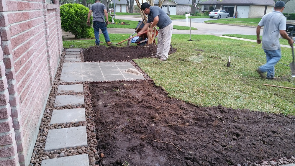 Stepping stones provide access to bench area and back of flower beds.