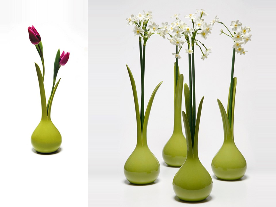 Stretching the limits between natural and artificial objects in order to raise the question where does the vase end and the flower start? Combining mass production with a one-of-a kind product in order to create a difference between the vases, similar to nature.   Material: ceramic stoneware      Size: H32-40 x W10 cm