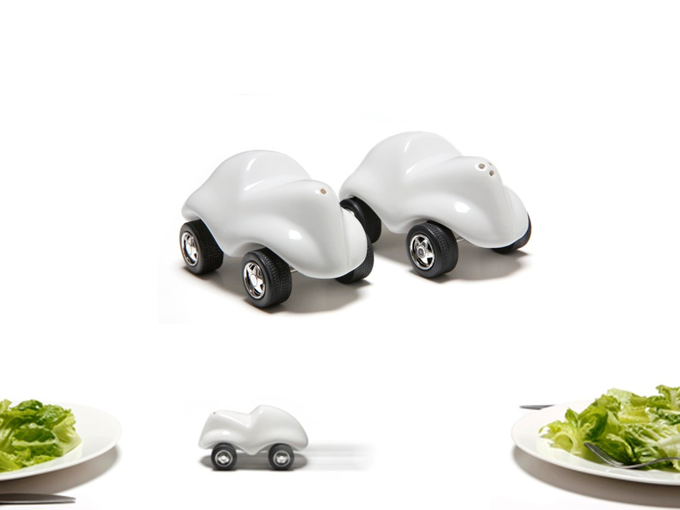 Salt and pepper shakers on wheels.   Material: stoneware ceramic, stainless steel and rubber wheels.       Size: H5 x W9 cm