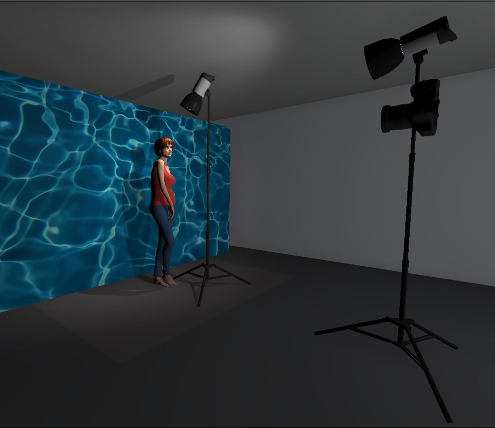 The setup shown above illustrates where I had the models light placed. It was quite close to the model and pointed down sharply to avoid any excess light spilling onto the projected image on the wall behind her. In this diagram the light next to the camera is actually there to represent the projector. Again here you can see that I had the projector above the models head height so that any shadows would be thrown behind her and hidden below her shoulders. I also further increased this by shooting slightly up at the model, this again ensured that there were minimal shadows distracting the overall shot.