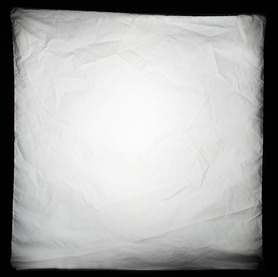 This is a stopped down shot of the front of my 60cmx60cm softbox when the flash is fired. It clearly shows that the centre of it is brighter than the edges and this brighter centre point is referred to as the 'hotspot'.