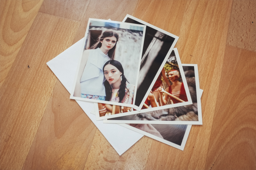 A pack of actual photos on photographic paper. Random but they're in there