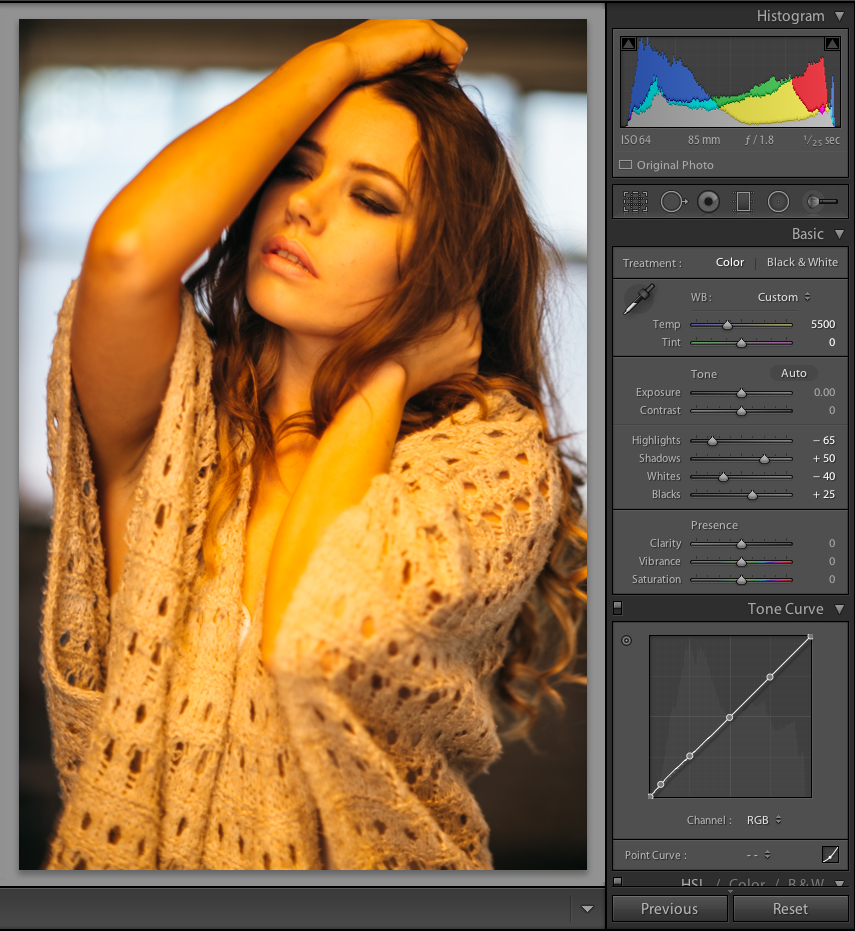 A shot taken in front of a daylight window with a CTO gel on our key light with a Kelvin value of 5500k.