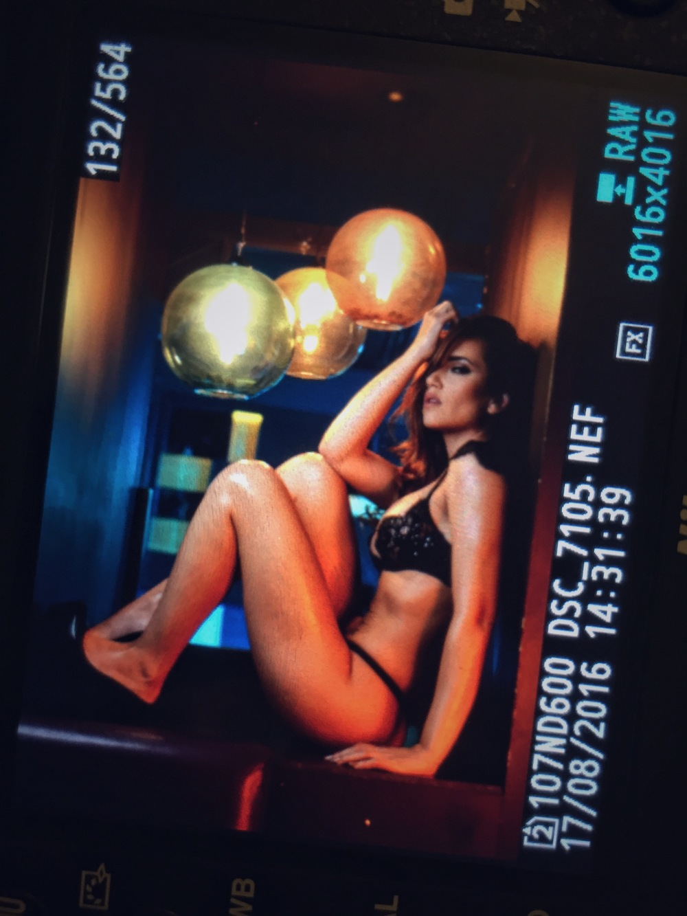 I only did this shoot a few days ago so it hasn't made it into the editing queue yet but here's a back of the camera shot of the club we were in. It had a couple of really low wattage goldfish bowl style bulbs which I wanted to include in the shot but to get any light to show I had to shoot at ISO 800 1/60 sec. at f2.8. This shot simply wasn't possible with my older slower lens.