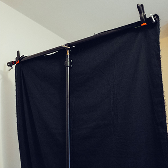 Get your stand to hold black velvet rather than a white sheet when needed.