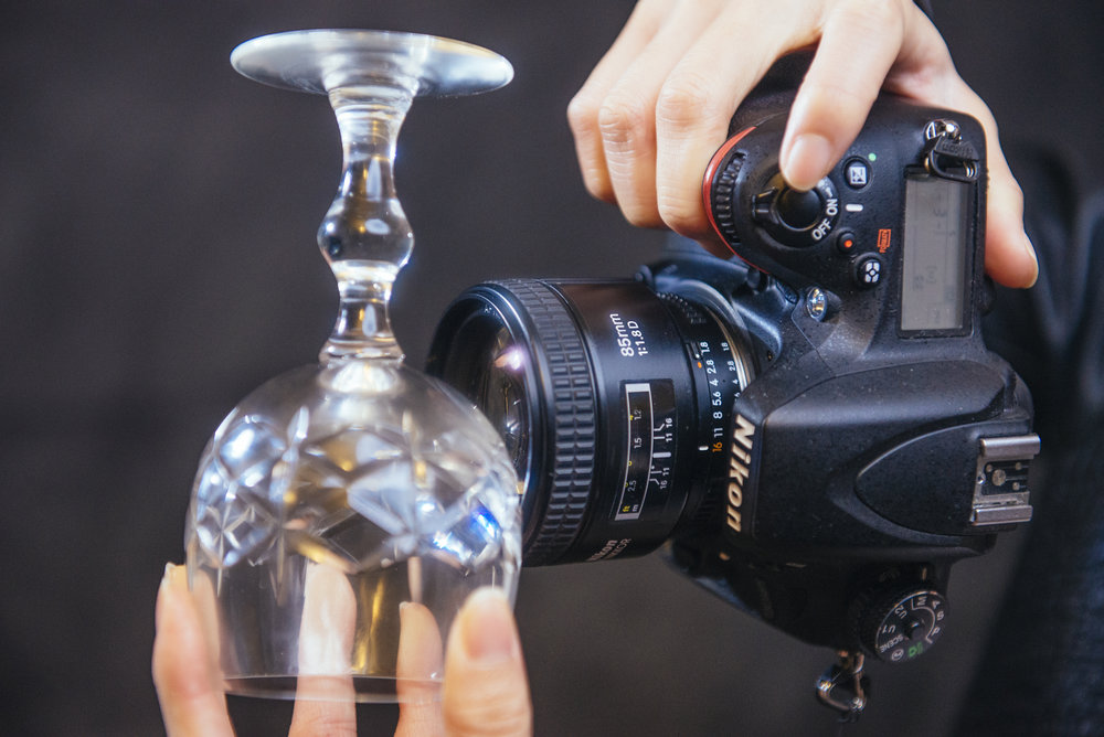 Holding the glass close to the lens will ensure the bokeh sparkle effect. Be careful to not let the glass scratch your lens though.