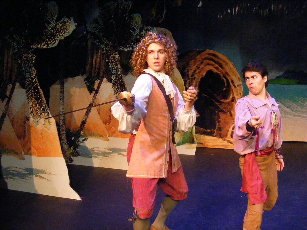 Ferdinand (Nicholas Browne) teaches Hippolito (Nick Benninger) about swordplay.
