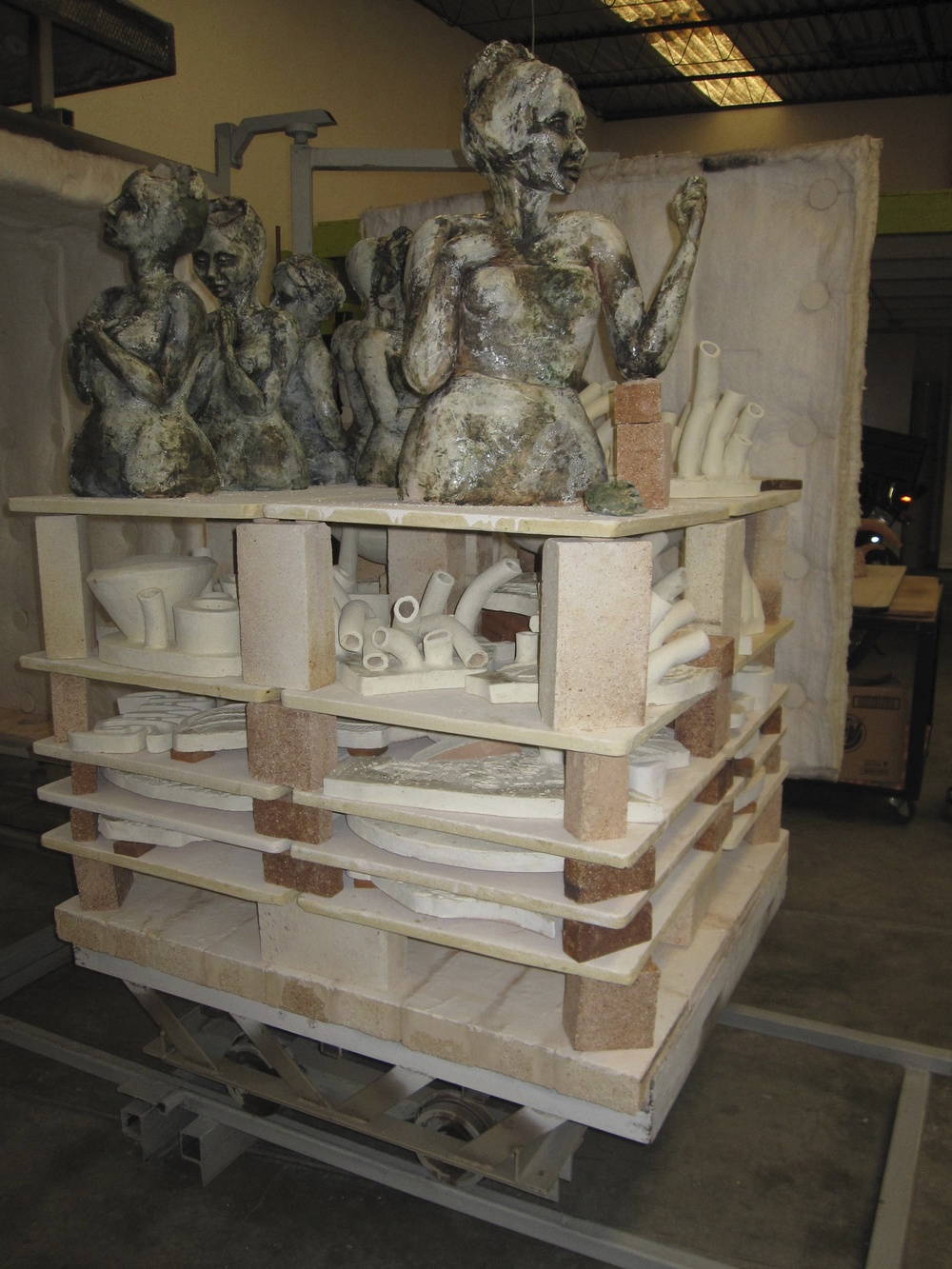 kiln ready to unload - female figure sculptures by Annie Evans